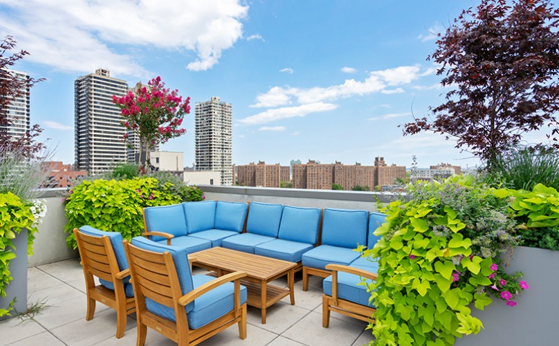 Rooftop Terrace with a view of the city and lounge seating