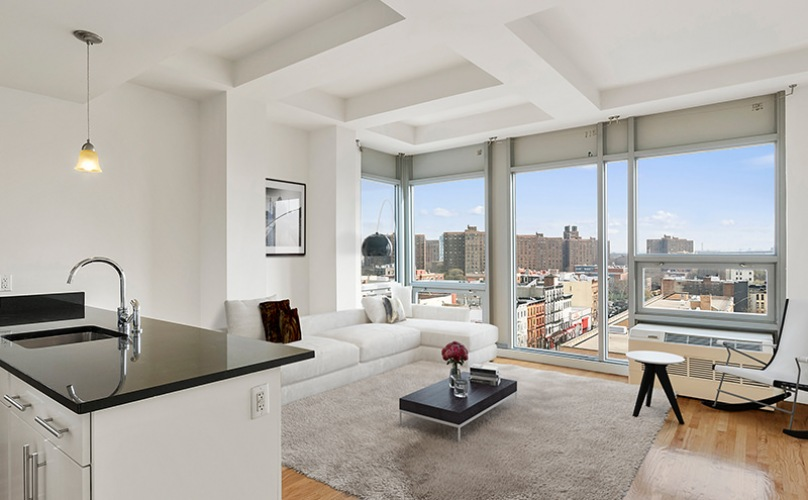 Living room open to the kitchen with floor-to-ceiling windows